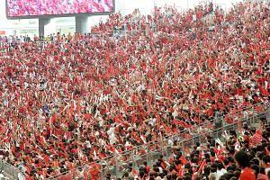 Singaporeans celebrating National Day Parade 2016 at National stadium.