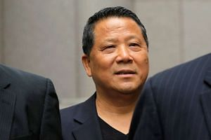 Macau real estate developer Ng Lap Seng, accused of bribing former UN General Assembly president John Ashe, exits US Federal Court in New York, on June 27, 2016.