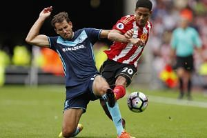 Middlesbrough's Christian Stuani (left) and Sunderland's Steven Pienaar fighting for the ball during the EPL match at the Stadium of Light on Aug 21, 2016.