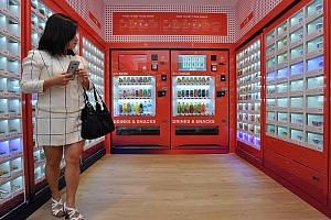 Pigeon-hole vending machines, dispensing hot, chilled and ambient products, at Block 320C Anchorvale Drive, on Aug 7, 2016.