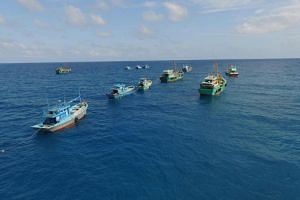 11 illegal fishing boats being sunk in the Natuna sea off the coast of Indonesia on Aug 17, 2016.