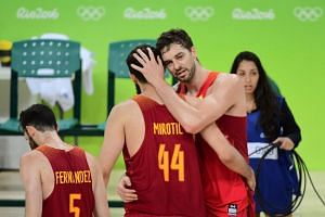 Spain's Pau Gasol hugs Spain's power forward Nikola Mirotic after Spain defeated Australia for the Bronze medal in men's basketball.