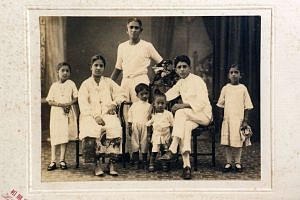Family portrait from the 1920s of a young Mr Nathan (third from right). At the back is his father Sellapan, and in front are (from left) sister Paruvatham, mother Abirami, sister Amurtham, his mother's favourite nephew and his eldest sister Sivayogam