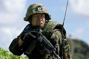 A soldier with the Japan Maritime Self-Defence Force at a simulated assault in Hawaii last month.