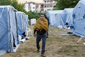 A man walking at a makeshift camp in Arquata on Aug 25, 2016, following the earthquake.