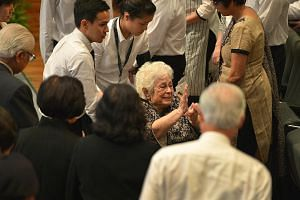 "Mrs Nathan waving to attendees as she left the University Cultural Centre auditorium yesterday. The 87-year-old has been hailed as the anchor for Mr Nathan. As PM Lee put it in the most poignant line in his eulogy for Mr Nathan: ""The central and brig"