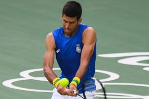 Djokovic hits a shot during an Olympic training session in Rio on Aug 2, 2016.