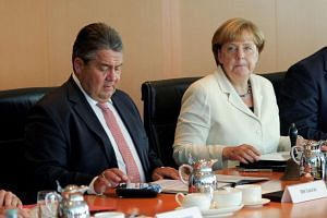 Economy Minister Sigmar Gabriel and Chancellor Angela Merkel attend a Cabinet meeting on Aug 24, 2016.
