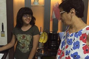 Eleven-year-old Abhitha showing the Rotimatic to her grandmother, Mrs Kotwal.