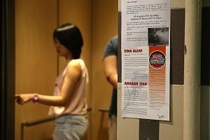 Leaflets on the Zika virus at the lift lobby of Block 102, Aljunied Crescent, where the first locally infected victim lives.