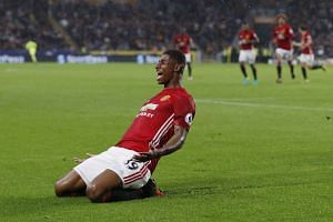 Manchester United's Marcus Rashford celebrates scoring their first goal against Hull.