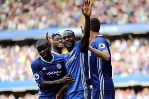 Chelsea's Victor Moses celebrates scoring their third goal.