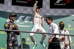 Mercedes driver Nico Rosberg (centre) celebrating on the podium, after coming in ahead of Red Bull's Daniel Ricciardo (left) and teammate Lewis Hamilton (right) at the Belgian GP on Aug 28, 2016.