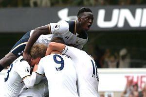 Tottenham Hotspur's English defender Danny Rose celebrates with teammates after scoring.