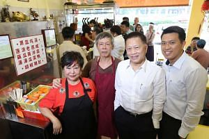 (From left) Madam Betty Kong and her husband Ha Wai Kay, with Michael Mun, Aztech Group's chairman, who bought the roast meat business, and his eldest son, Jeremy Mun.