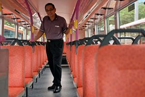 Bus driver Mr Lim Yew Huat, 65, has been with SBS for 41 years. SMRT bus drivers can now keep working till 69.