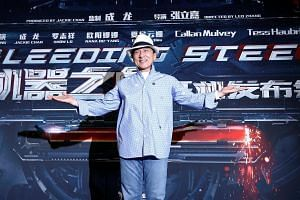 Jackie Chan poses for the cameras at the announcement of the beginning of production for the science fiction action film Bleeding Steel in Sydney on Aug 25.
