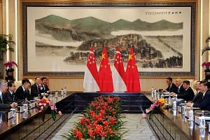 PM Lee and President Xi, and their respective delegations, meeting for bilateral talks at the West Lake State Guesthouse yesterday on the sidelines of the Group of 20 leaders' summit.