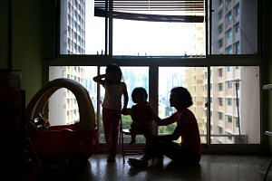 Mrs Suparmi Foo (right) with her two Singaporean daughters, five-year-old Gerardin (left), and two-year-old Carolyn.