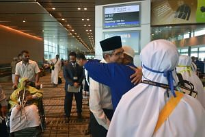 Minister-in-charge of Muslim Affairs Yaacob Ibrahim sends off two groups of Haj pilgrims at Changi Airport on Sept 5, 2016.