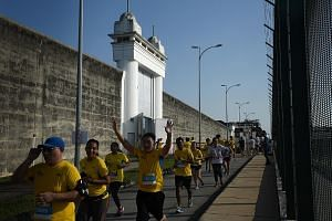 Participants in the 10km category of the Yellow Ribbon Prison Run at the entrance gate and wall of Changi Prison, which was the finishing point of the race. The event raised some $123,000 for the Yellow Ribbon Fund, which helps former inmates.