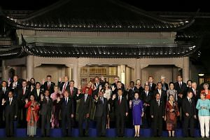 Mr Xi (front row, seventh from left) and his wife Peng Liyuan with US President Barack Obama (front row, fifth from left), Singapore Prime Minister Lee Hsien Loong (second row, fifth from left) and his wife Ho Ching, as well as other leaders and thei