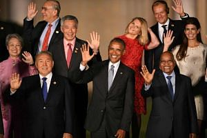 Prime minister Lee Hsien Loong (2nd left) and Mrs Lee, with G20 leaders and their spouses, including US President Barack Obama (centre), Kazakhstan's President Nursultan Nazarbayev (front left), South Africa's President Jacob Zuma, and European Counc