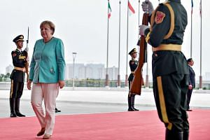 German Chancellor Angela Merkel arrives at the G20 Summit in Hangzhou, China, on Sunday (Sept 4).
