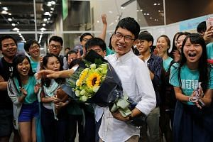 Mr Nathan Law, the election's youngest candidate at 23, celebrating yesterday with supporters after he won a seat in the Legislative Council. Sunday's polls were the first major election after 2014's Occupy protests, which many young localist candida