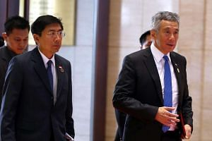 Singapore's Prime Minister Lee Hsien Loong (right) arrives at the National Convention Center (NCC), the venue of the Asean Summit in Vientiane, Laos, on Sept 7, 2016.