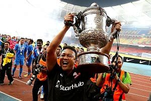 Fandi Ahmad lifting the Malaysia FA Cup after the final between LionsXII and Kelantan last year. The former LionsXII coach has six years of experience coaching overseas. He coached Pelita Raya in Indonesia and Johor Darul Takzim in Malaysia.