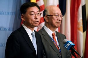 South Korean Ambassador Hahn Choong-hee (left) speaks to the press next to Japanese Ambassador Koro Bessho (right) following the UN closed-door meeting.
