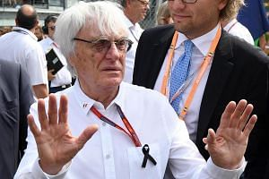 Formula One boss Bernie Ecclestone gestures ahead of the Italian Grand Prix at the Monza circuit on Sept 4, 2016.