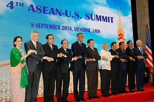 (From left) Myanmar's State Counsellor Aung San Suu Kyi, Prime Minister Lee Hsien Loong, Thailand's Prime Minister Prayut Chano-cha, Vietnam's Prime Minister Nguyen Xuan Phuc, US President Obama, Laos Prime Minister Thongloun Sisoulith, Philippines F