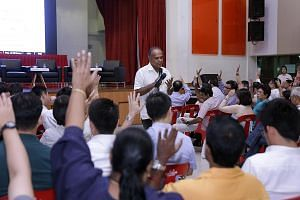 Law Minister K. Shanmugam speaking at a dialogue on proposed changes to the elected presidency with 600 grassroots leaders from the North West District yesterday. He pointed out that the Constitutional Commission had also acknowledged that the head o