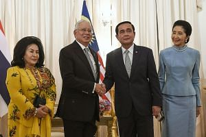 Malaysia's Mr Najib (second from left) and Thailand's Gen Prayut with their wives, Madam Rosmah Mansor (left) and Mrs Naraporn Chan-o-cha, at Government House in Bangkok yesterday.