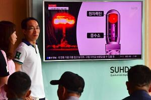 A TV news report on North Korea's latest nuclear test is shown at a railway station in Seoul.