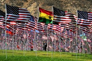 Students and staff from Pepperdine University placed around 3,000 flags in the ground in tribute to the nearly 3,000 victims lost in the attacks, seen here on Sept 10, 2016.