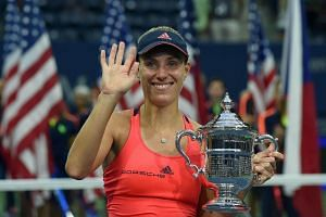 Angelique Kerber of Germany posing with her winning trophy after defeating Karolina Pliskova of Czech Republic in their 2016 US Open Women's Singles final match, on Sept 10, 2016.