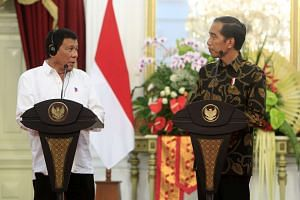 Indonesian President Joko Widodo (right) and the President of the Philippines Rodrigo Duterte speak at a joint news conference in Jakarta on Sept 9, 2016.