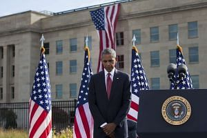 President Barack Obama, during a moment of silence at a ceremony marking the Sept. 11 terrorist attacks, at the Pentagon on Sunday (Sept 11).