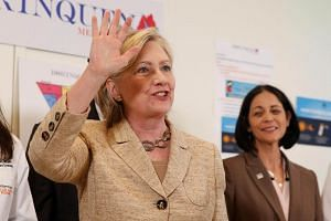 US Democratic presidential nominee Hillary Clinton waving after speaking during a visit to Borinquen Health Care Center in Miami, Florida, on Aug 9, 2016.