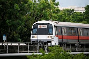 An SMRT train arrives at a station in Singapore on July 19, 2016.