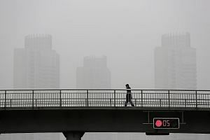 Heavy smog in Shanghai. Mr Lee thinks his cancer might have been triggered by his frequent work trips to China, where air pollution is a major problem in some cities, and where he was often surrounded by heavy smokers.