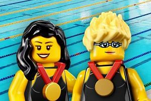 Lego's minifigures of Singapore para-swimmers Yip Pin Xiu (left) and Theresa Goh.