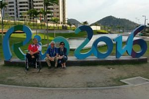 Theresa Goh (in wheelchair) and her parents, Mr Bernard Goh and Ms Rose Mok at the Athletes' Village in Rio on Sept 13 (Brazil time).