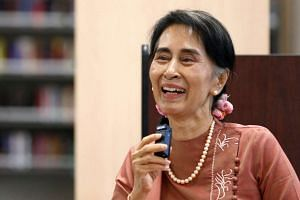 Myanmar's State Counsellor Aung San Suu Kyi speaks to students in a round-table discussion on a visit to Roosevelt High School in Washington, US on Sept 15, 2016.
