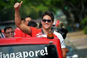 "Olympic gold medalist Joseph Schooling (above) told Paralympics medalists Yip Pin Xiu and Theresa Goh to ""soak in the celebrations"" when they return to Singapore."