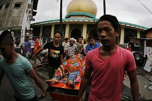 Relatives carrying the body of an alleged drug dealer killed during a police operation at a Manila mosque on Friday. The Human Rights Watch reported that out of 671 documented cases of extrajudicial killings from August 1998 to May 2008, half of the