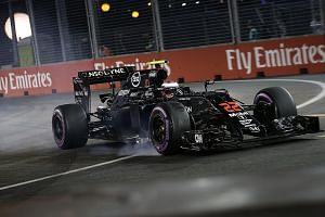 McLaren's Jenson Button losing control of his car after clipping the wall at Turn 14 and puncturing his rear left tyre during qualifying. He was forced to stop by Turn 16 and will start in 13th place after failing to reach Q3.
